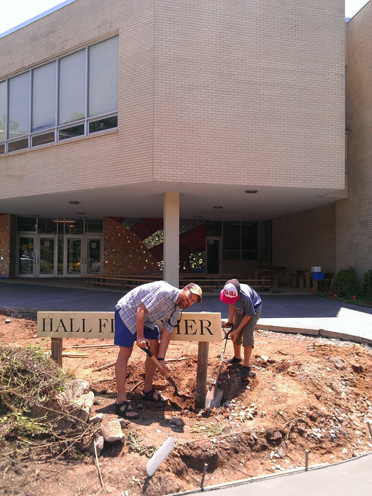 Gordon and Dad digging out the crooked Hall Fletcher sign.