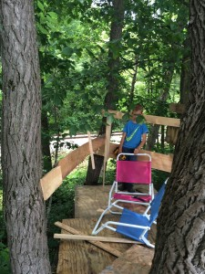 The partly finished back walls, and Blake setting up our lawn chairs.